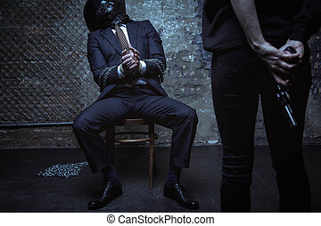 Frozen helpless executive begging for mercy