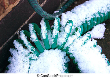 frozen hosepipe - hosepipe covered in snow