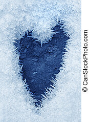 Frozen ice crystals on the ground a heart shape