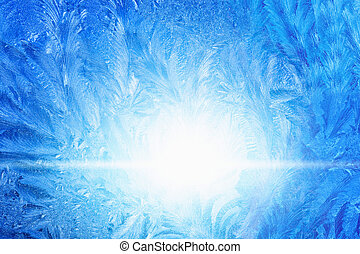 Winter background - blue icy frozen window glass with bright sunlight, pattern looks like fir-tree branch
