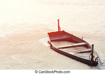 Frozen Into Ice Of River, Lake, Pond Old Wooden Boat