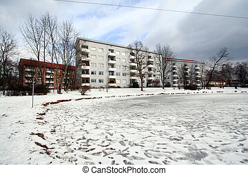 Frozen Lagoon - Frozen lagoon beside a residential building.