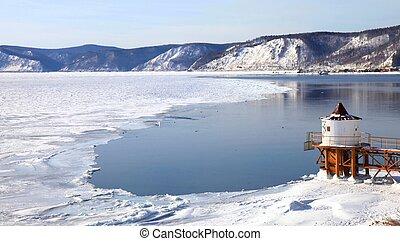 Frozen Lake Baikal in winter. Day. Nobody.