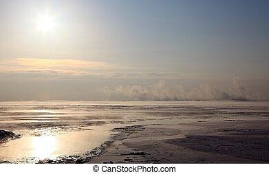 Frozen Lake Baikal. Sunset.