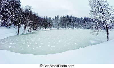 Frozen lake - Gopro 4 quadcopter aerial view of the frozen...