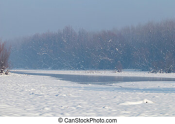Frozen lake in forest. winter lake under snow