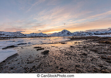 Frozen lake in the sunset
