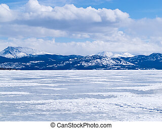 Frozen Lake Laberge winter landscape Yukon Canada - Cold icy...