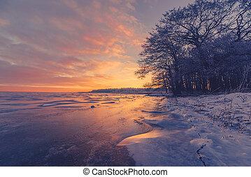 Frozen lake scenery in the sunrise