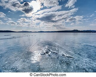 Frozen lake. Studying of climatic and weather changes.