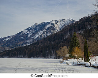 Frozen lake with mountains in the background