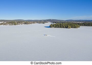 Frozen lake with snow drone photo