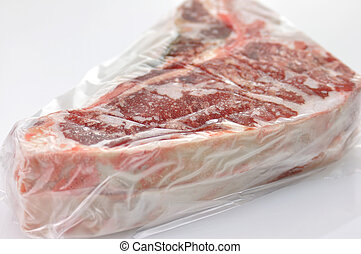 frozen meat wrapped in plastic
