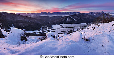 Frozen mountain with red sky at sunset