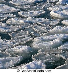 Frozen  ocean - broken piece of  ice in sea water