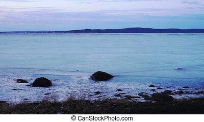 Frozen Onega lake shore in twilight - Scenery view at Onega...