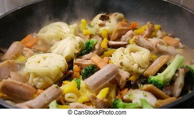 frozen pasta blocks defrost thaws steaming cooking pan.