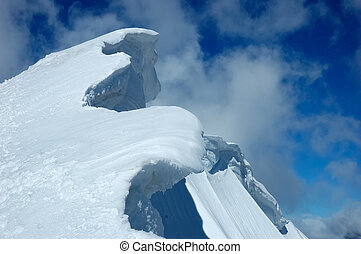 Frozen ridge - Detail of high mountain ridge over cloudy sky