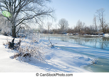 winter season - frozen river and trees in winter season