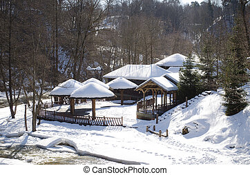 frozen river bay water wooden house bank roof snow