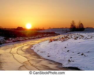 frozen river in sunrise