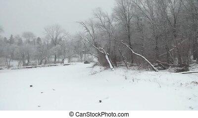 Frozen River in Winter (panning lef - Panning left across...