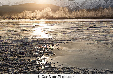 Frozen river with sun glow