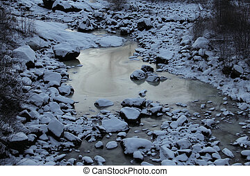 Frozen riverbed in winter