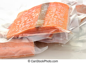 frozen salmon fillets in a vacuum package