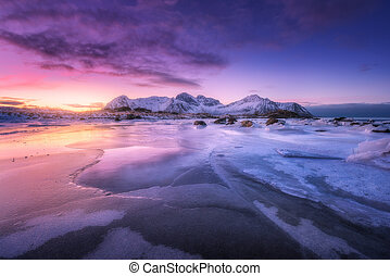 Frozen sea coast at colorful sunset in Lofoten islands, Norway