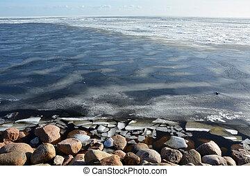 Frozen sea shore at the spring season