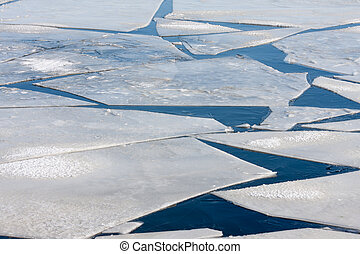 Frozen sea with pattern of ice floes