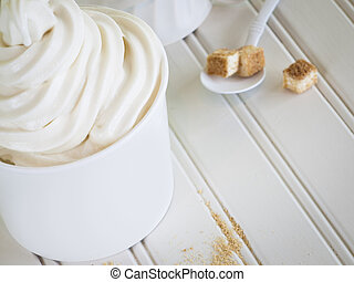 Frozen Soft Serve Yogurt. - Cup of cheesecake frozen yogurt...