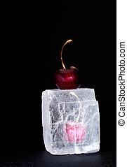 Frozen sweet cherry on black background