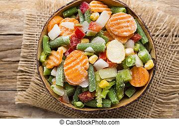 Frozen vegetables. - Frozen vegetables  in a wooden table.