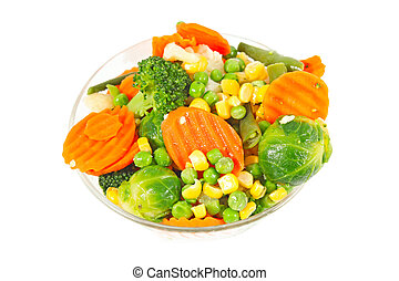 Frozen vegetables in a glass bowl on a white background
