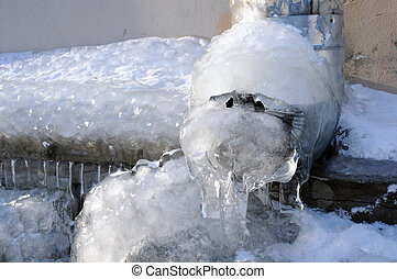 Frozen Water in the Downspout - Frozen water in the...