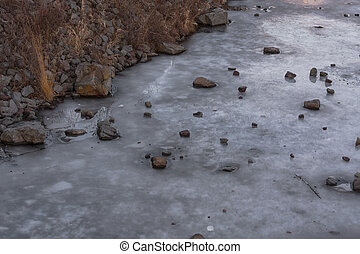 Frozen water surface of a river.