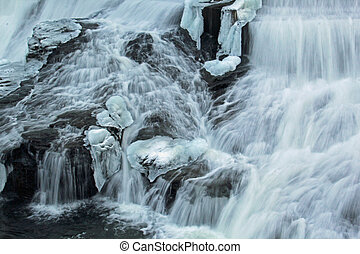 Frozen waterfall flow from an electrical barrage with overflow of water