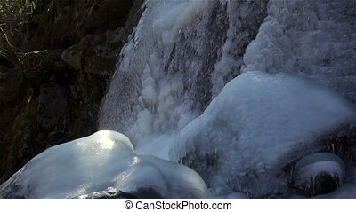 Frozen waterfall. Nature background. Ice waterfall in winter.