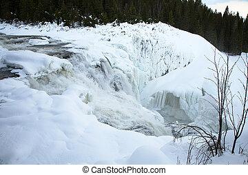 frozen waterfall Tannforsen in winter, Sweden
