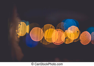 Frozen window with Blurred Defocused light of Night City, abstract background
