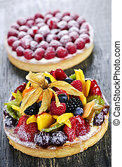 Fruit and berry tarts - Fresh dessert tarts with assorted...
