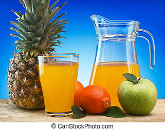 Fruit and juice on a wooden table