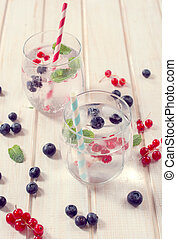 Fruit and soda water - Selective focus on the berry fruit in...