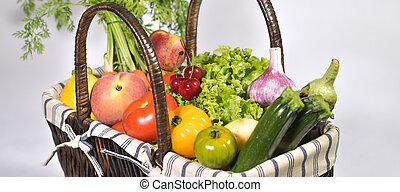 Fruit and vegetable in a basket, white background