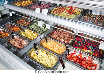 Fruit and vegetable salads for sale - Sales display at a...