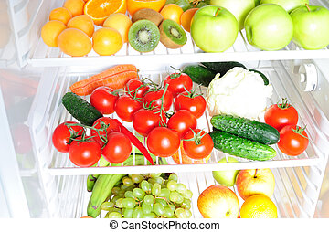 Fruit and vegetables in the fridge - Fruit and vegetables on...