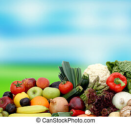 Fruit and vegetables on blurred background - Fruit an...