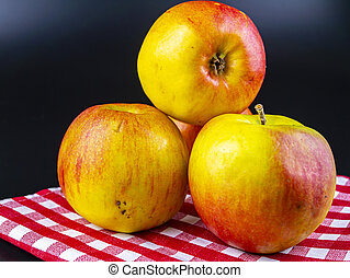 Fruit apples on a black background with place for text.